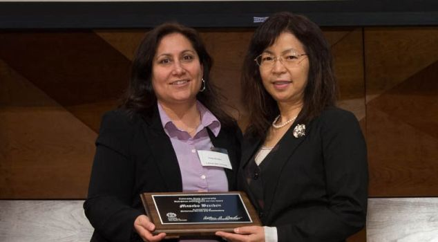 "Tonja Rosales presents Masako ""Mako"" Beecken with the Multiethnic Faculty and Staff Distinguished Service Award at the 2014 Celebrate! Colorado State University Awards"